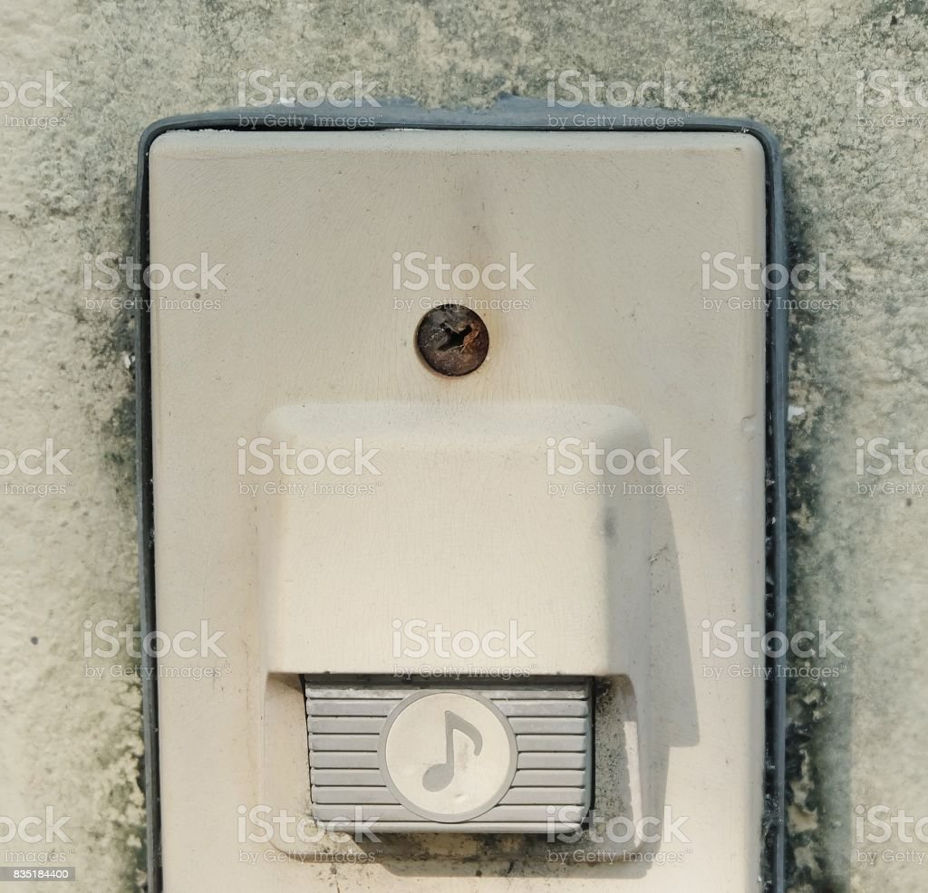 Electronic Old Doorbell on The Concrete Wall stock photo