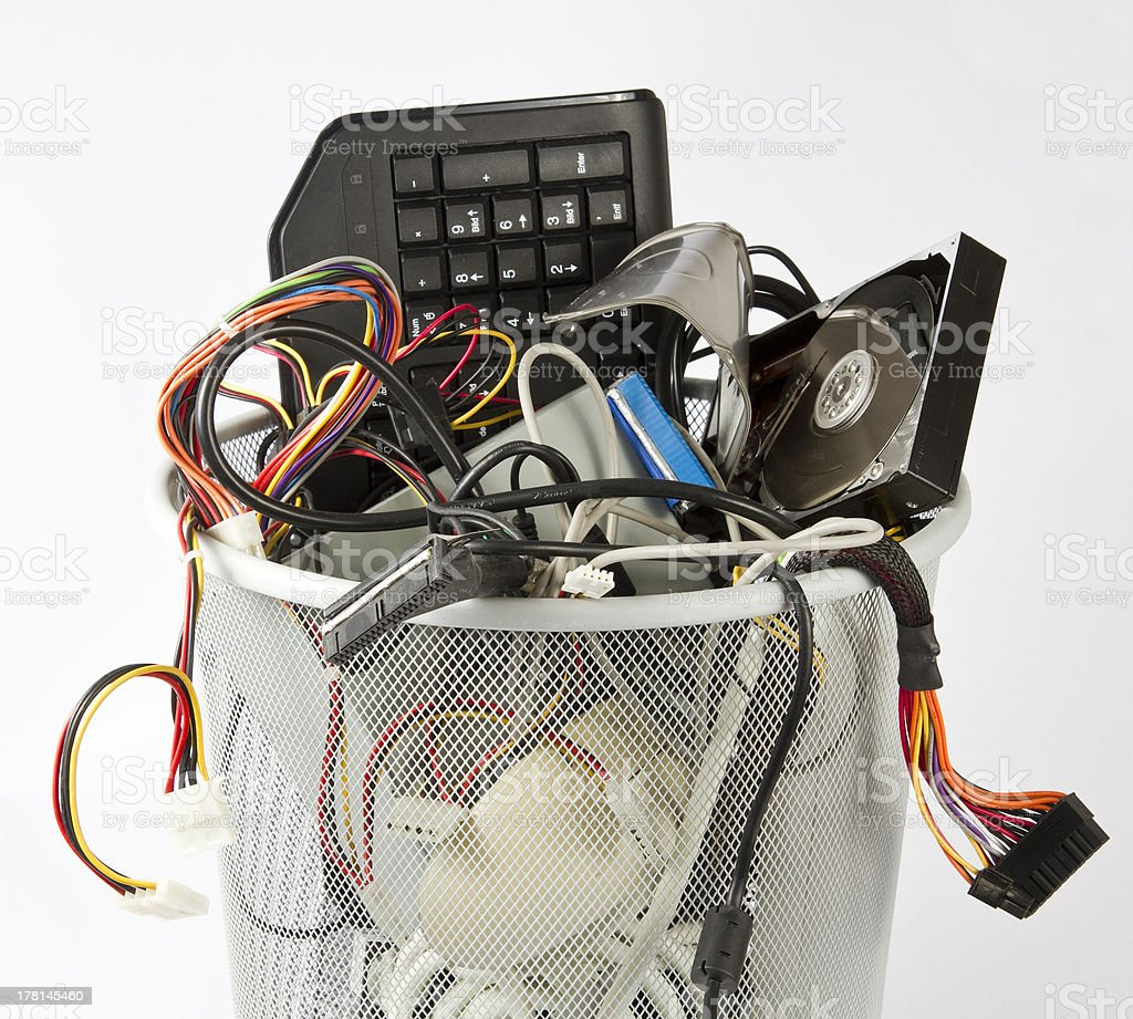 electronic parts from computers in trash can stock photo