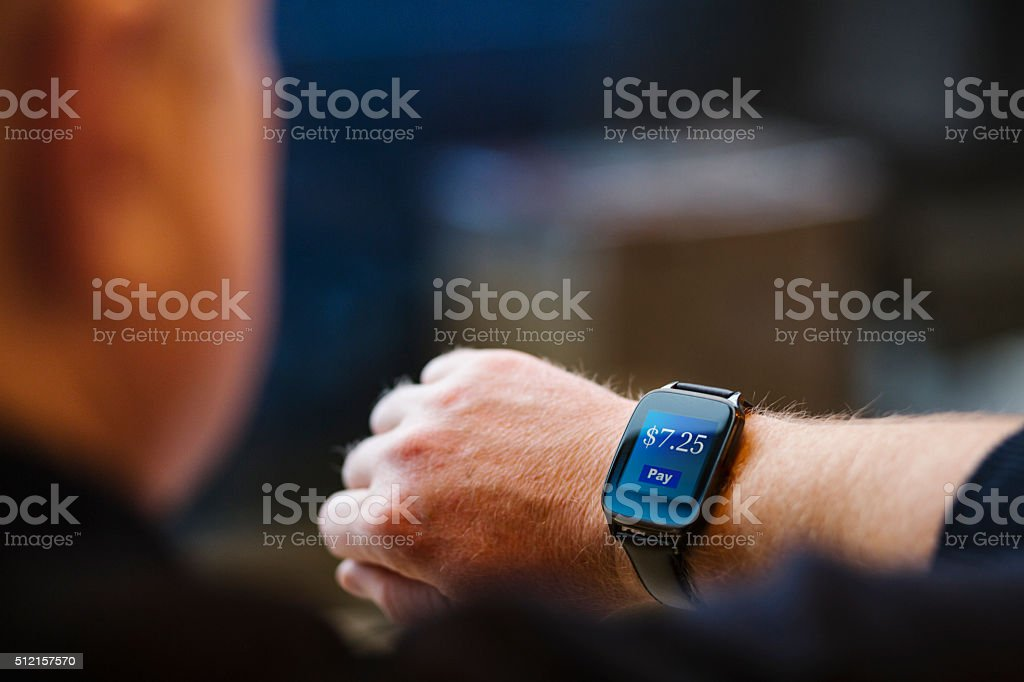Electronic payment on a Smart Watch stock photo