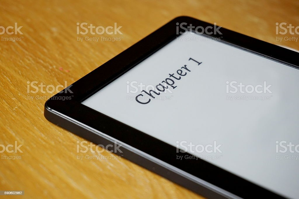 Electronic reader with displayed caption Chapter One in electronic Ink stock photo