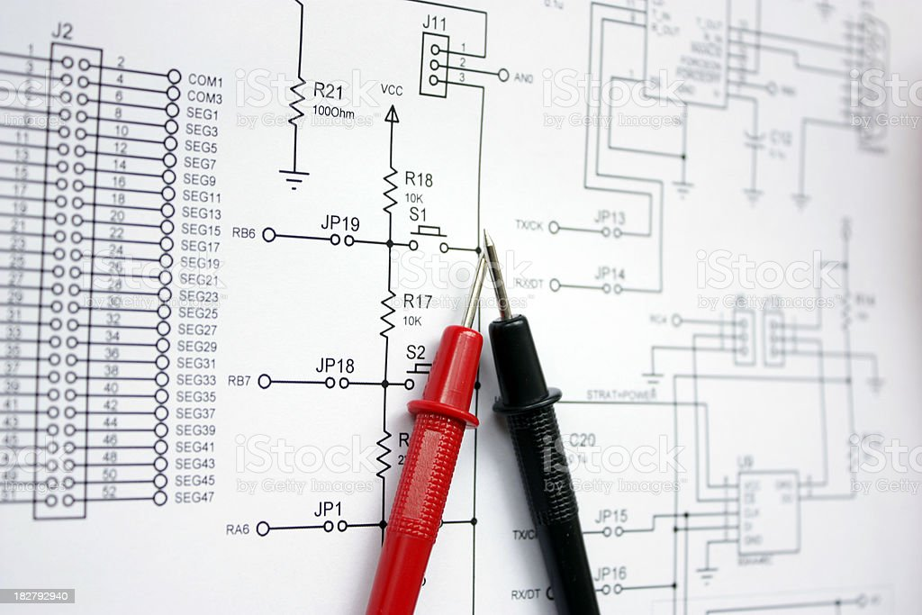 Electronic schematic and multimeter royalty-free stock photo