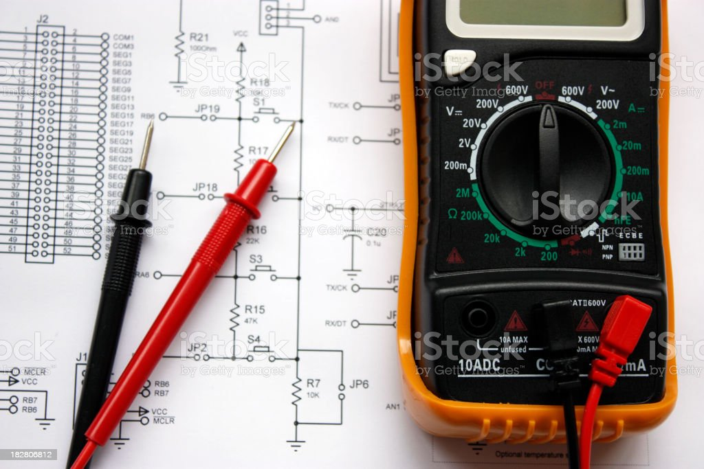 Electronic schematic and multimeter stock photo