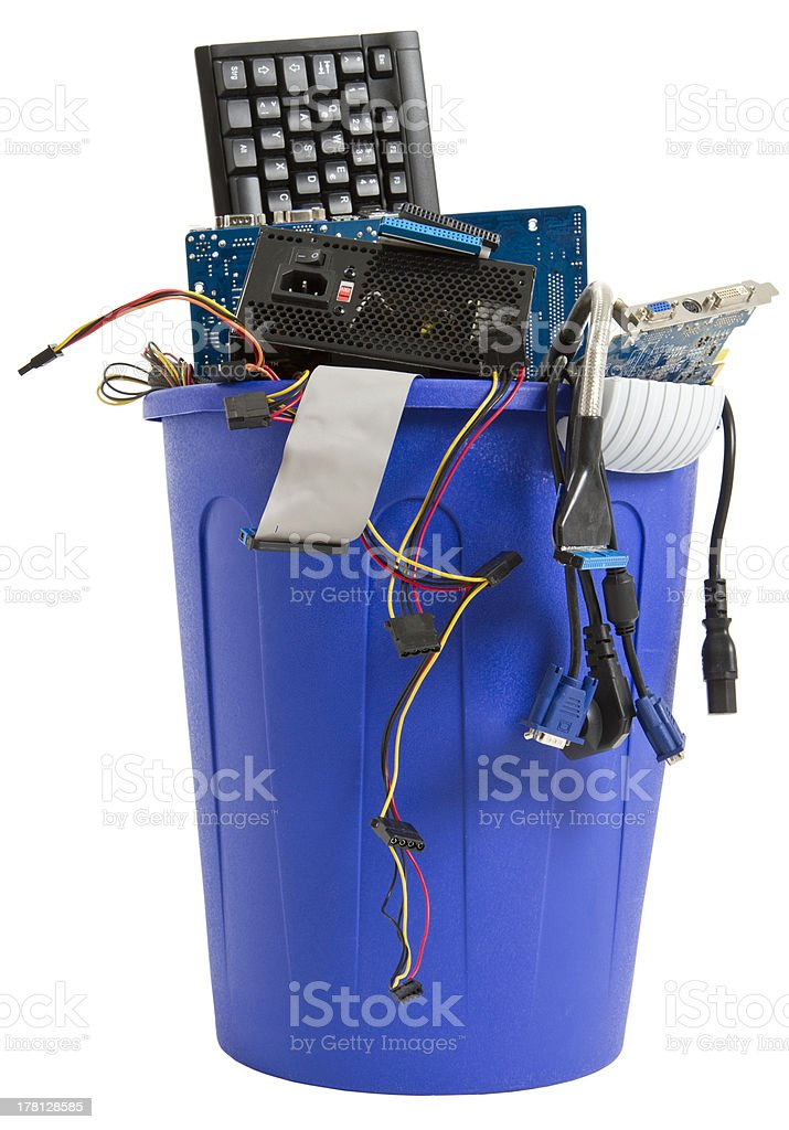 electronic scrap in blue trash can royalty-free stock photo