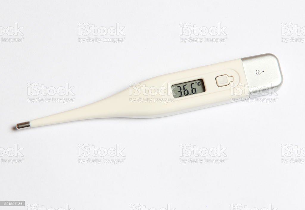 Electronic thermometer on a white background stock photo