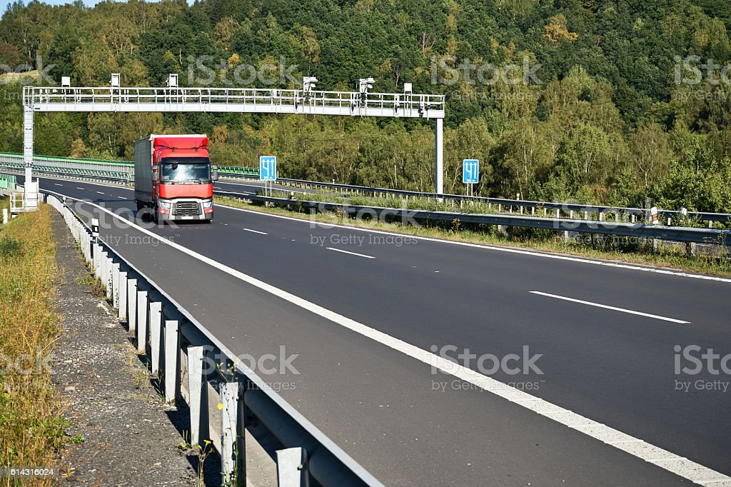 Electronic toll collection with a passing red truck stock photo