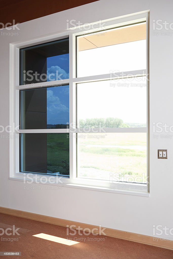 Electronically Tintable Glass Window Comparison royalty-free stock photo