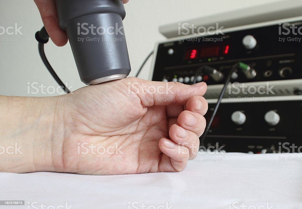 Electrotherapy in physiotherapy stock photo