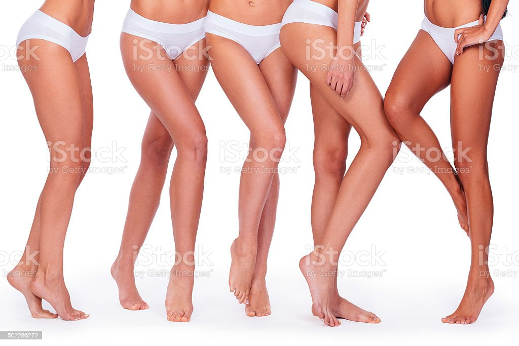 Close-up of five women in white panties showing their perfect legs...