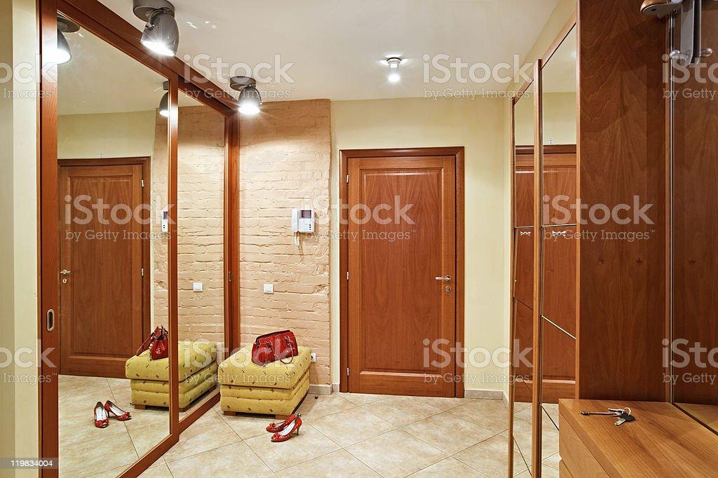 Elegance anteroom interior in warm tones with hallstand stock photo