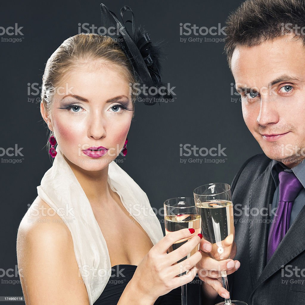 Elegance couple celebrating New Years Day or Party with champaign royalty-free stock photo
