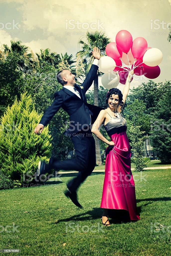 Elegance couple with balloons royalty-free stock photo