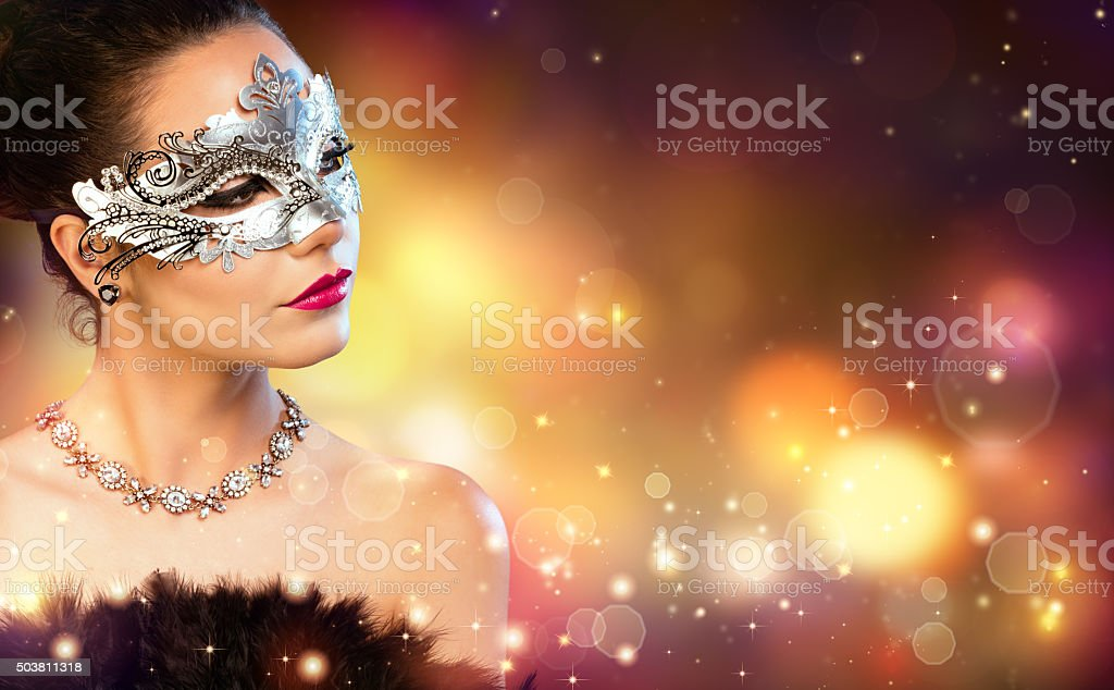 Elegance Woman Wearing Carnival Mask With Golden Stardust stock photo