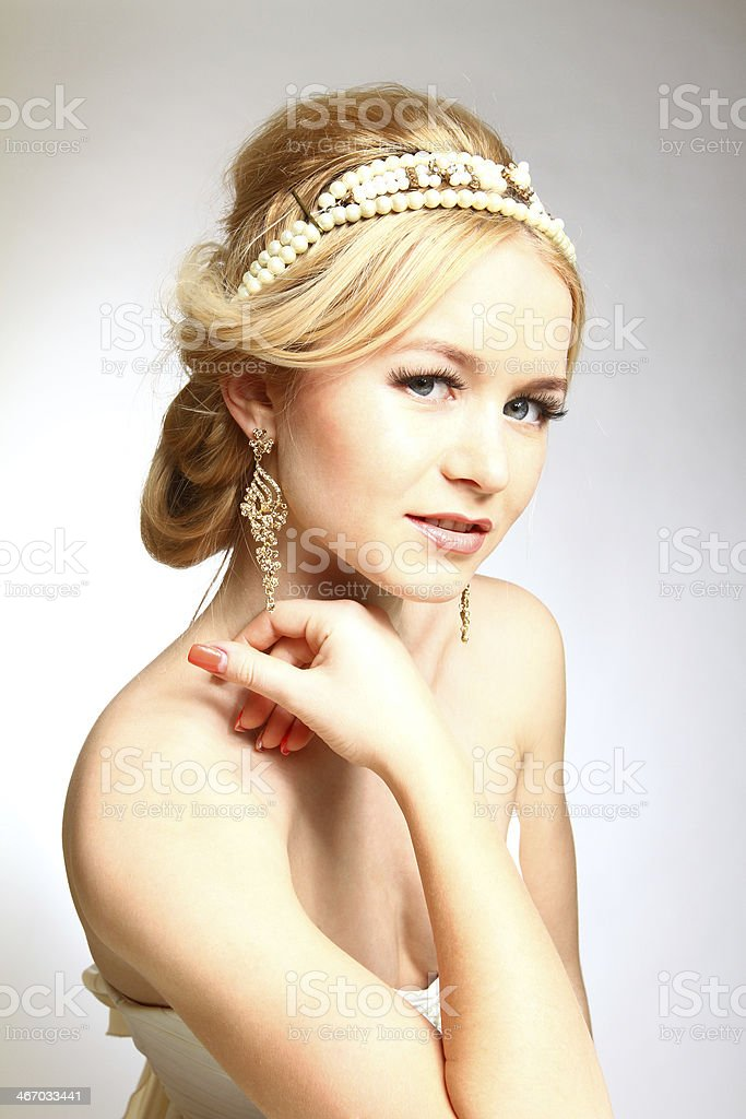 Elegance young woman Greek styled on gray background royalty-free stock photo