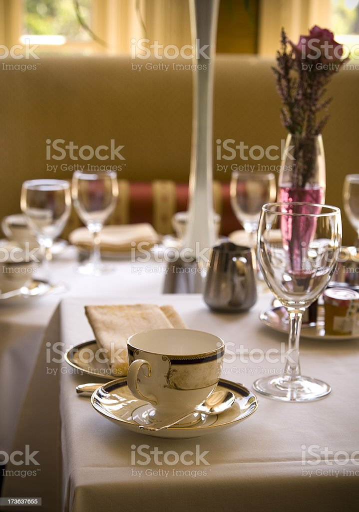 Elegant Afternoon Tea Dining Table, Vase, Cups & Place Setting royalty-free stock photo