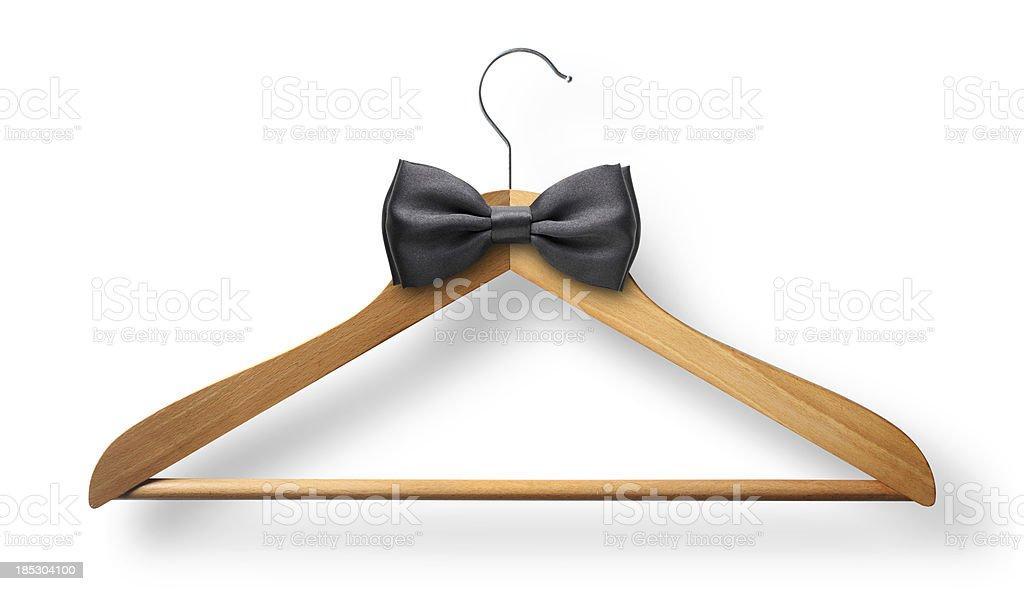 Elegant attire. Coat hanger with bow tie. royalty-free stock photo