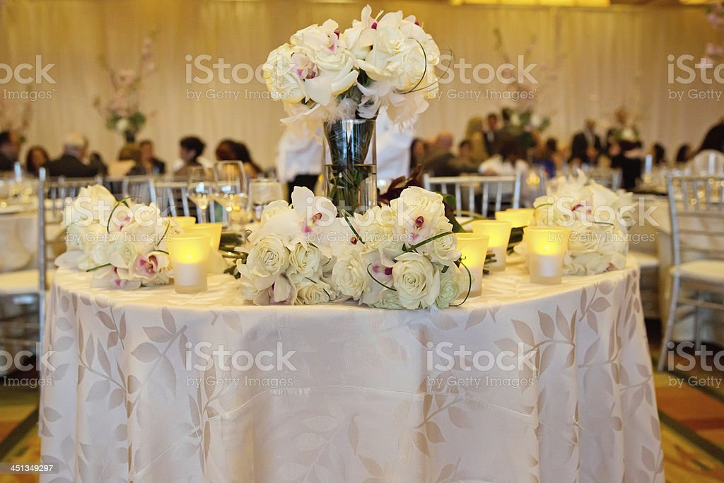 Elegant Banquet table adorned with flowers and candles royalty-free stock photo