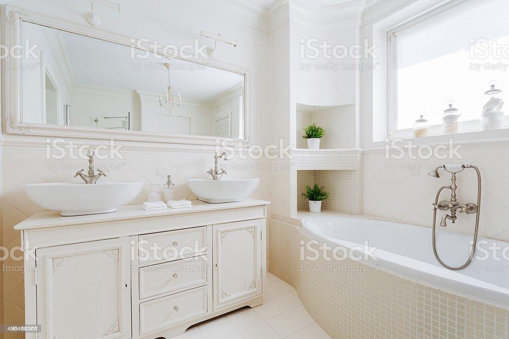 Elegant bathroom with white fittings stock photo