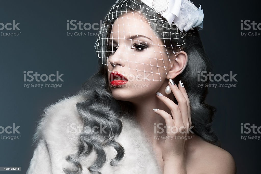Elegant beautiful girl with silver curls and veil. stock photo