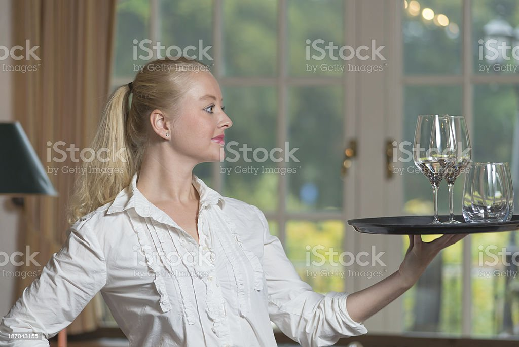 Elegant beautiful woman serving drinks royalty-free stock photo
