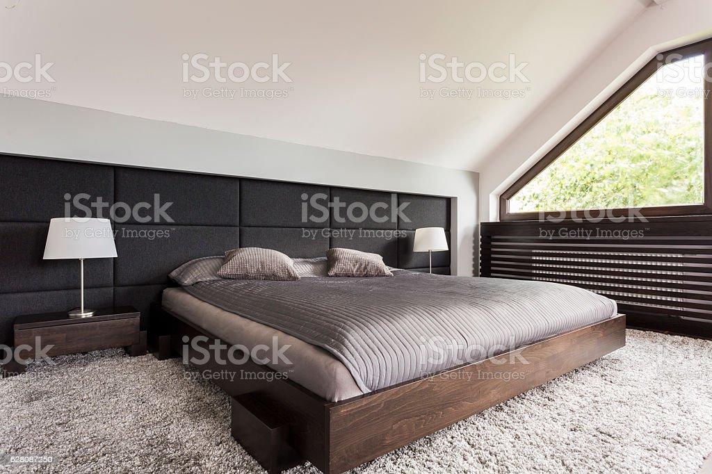 Elegant bed in dark frame stock photo
