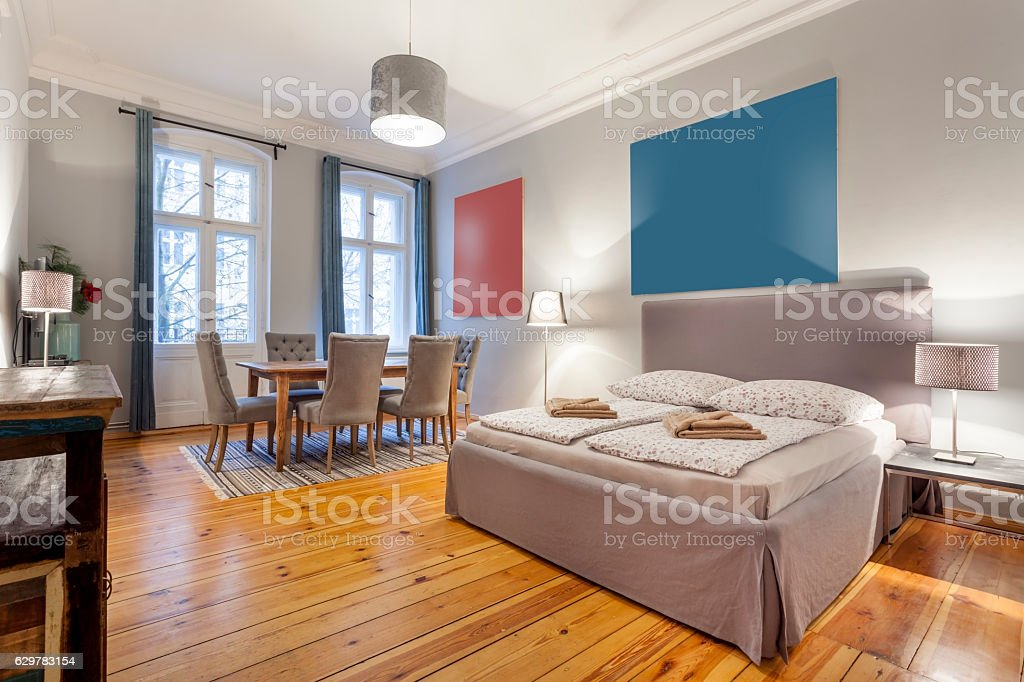 Elegant Bedroom with King Sized Bed and Dining Table stock photo