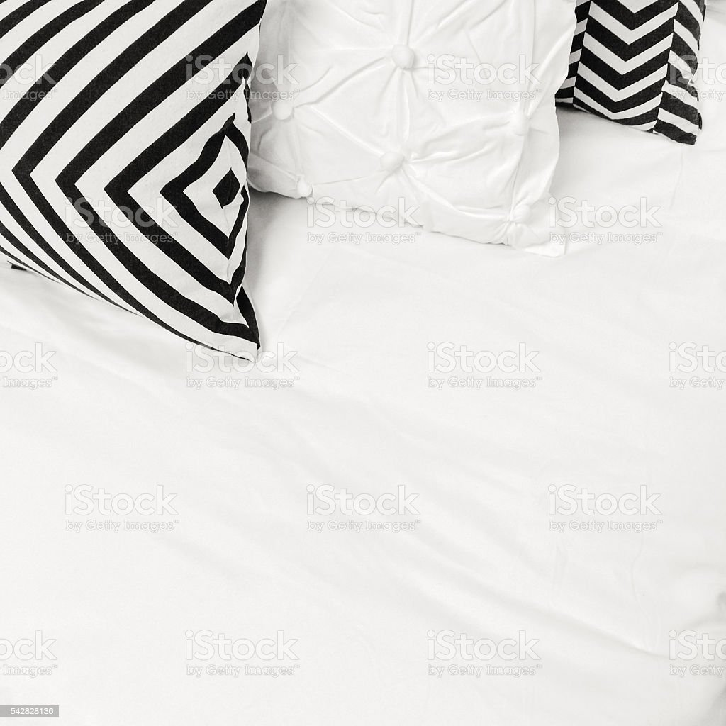Elegant black and white bed linen with geometric design.