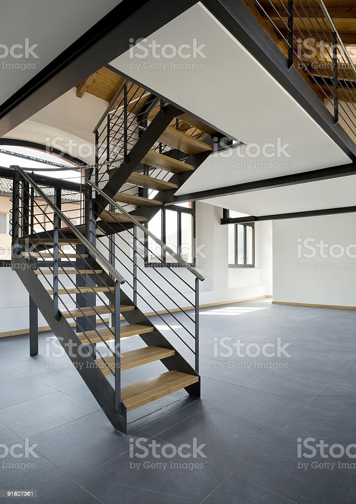 Elegant black staircase in the middle of an empty flat royalty-free stock photo