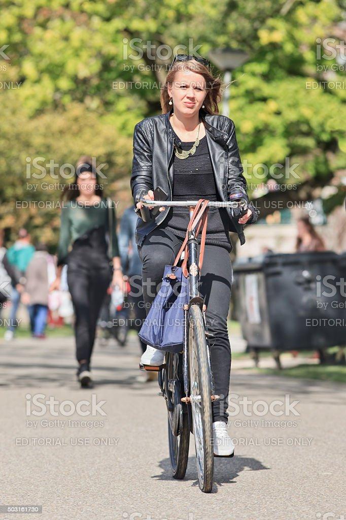 Elegant blond girl enjoy cycling in Amsterdam Vondelpark stock photo