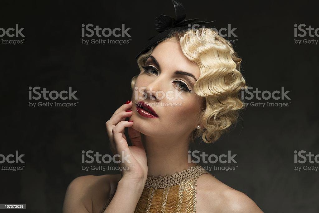 Elegant blond retro woman wearing little hat royalty-free stock photo