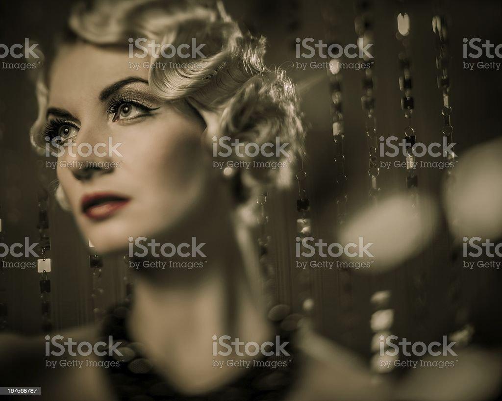 Elegant blond retro woman with beautiful hairdo royalty-free stock photo