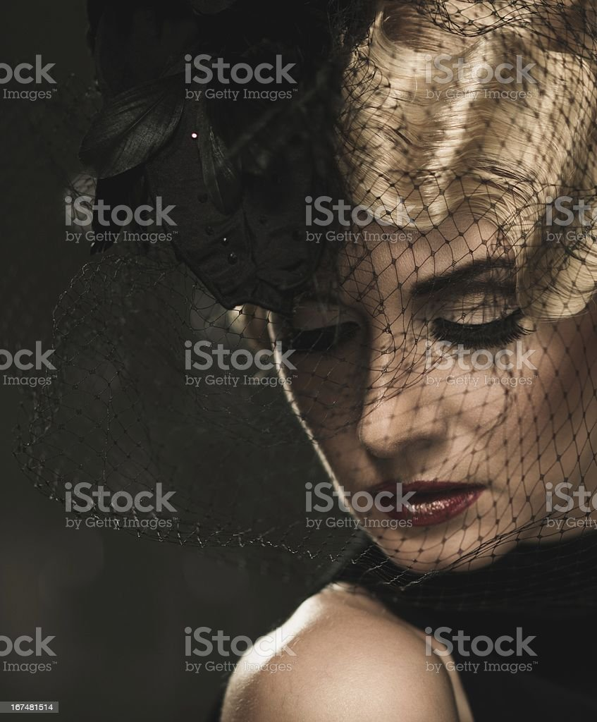 Elegant blond retro woman  with red lipstick wearing little hat stock photo