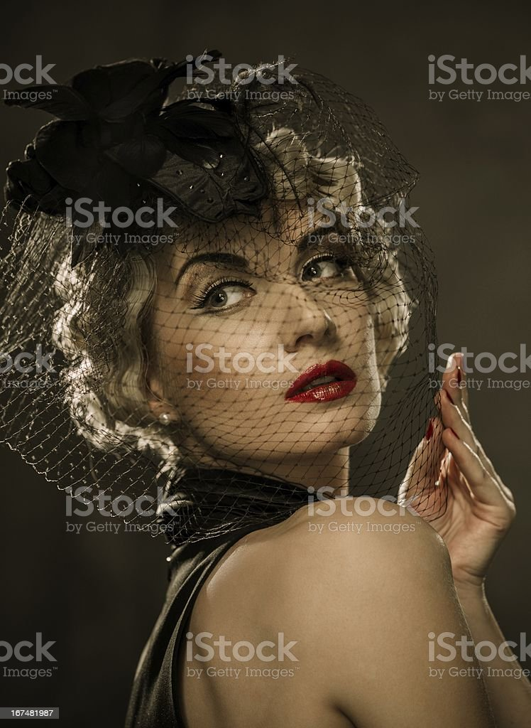 Elegant blond retro woman  with red lipstick wearing little hat royalty-free stock photo