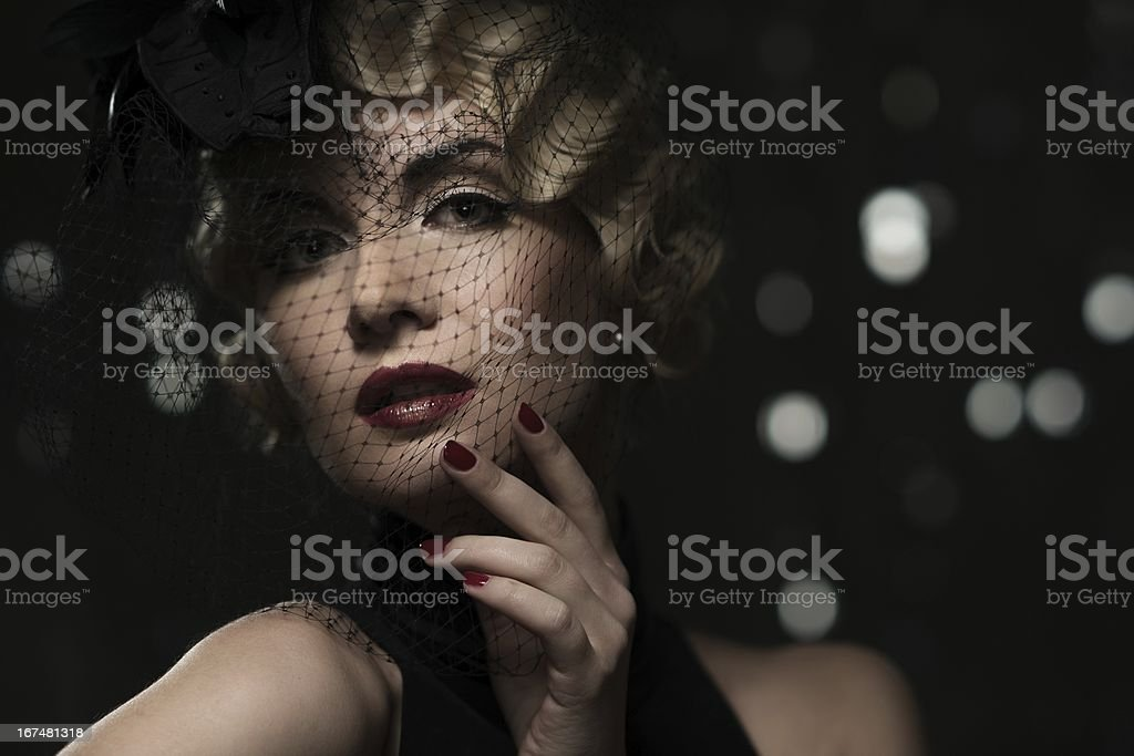 Elegant blond retro woman  with red lipstick wearing little royalty-free stock photo