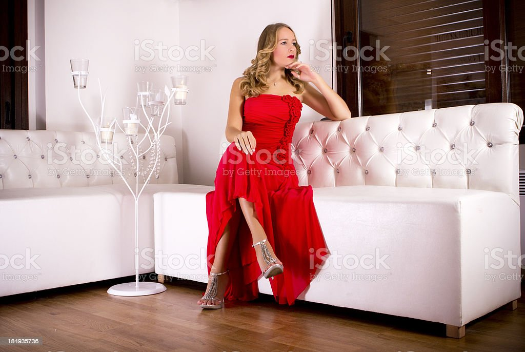 Elegant blond woman with red dress royalty-free stock photo