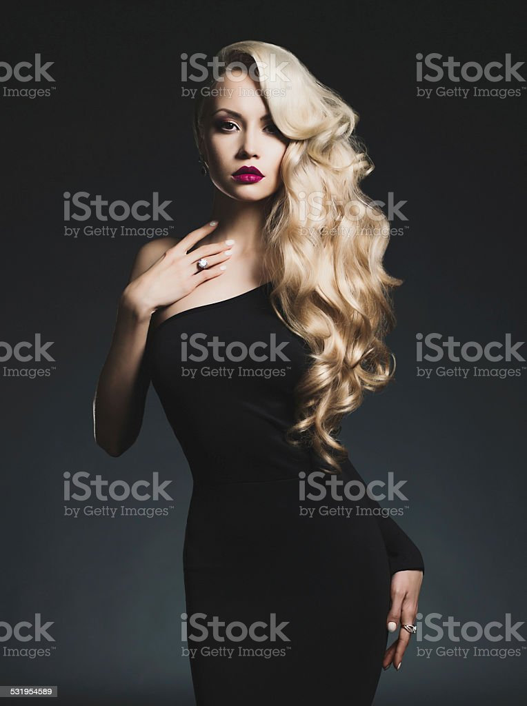 Elegant blonde on black background stock photo