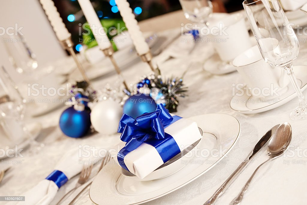 Elegant blue and white Christmas table setting royalty-free stock photo