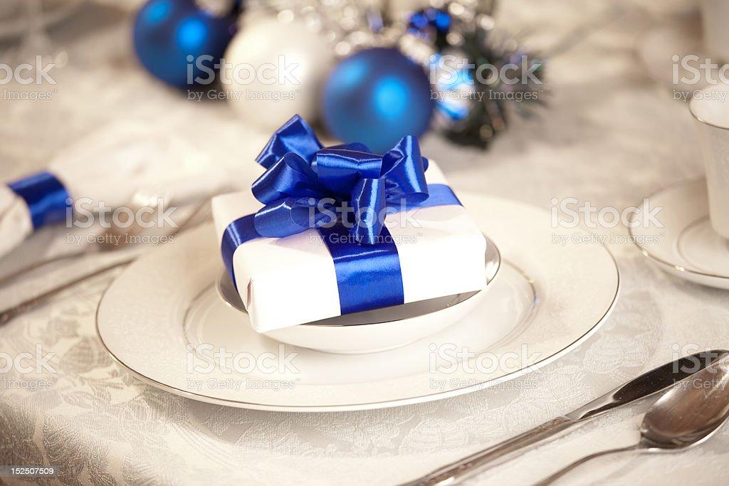 Elegant blue and white Christmas table setting royalty-free stock photo