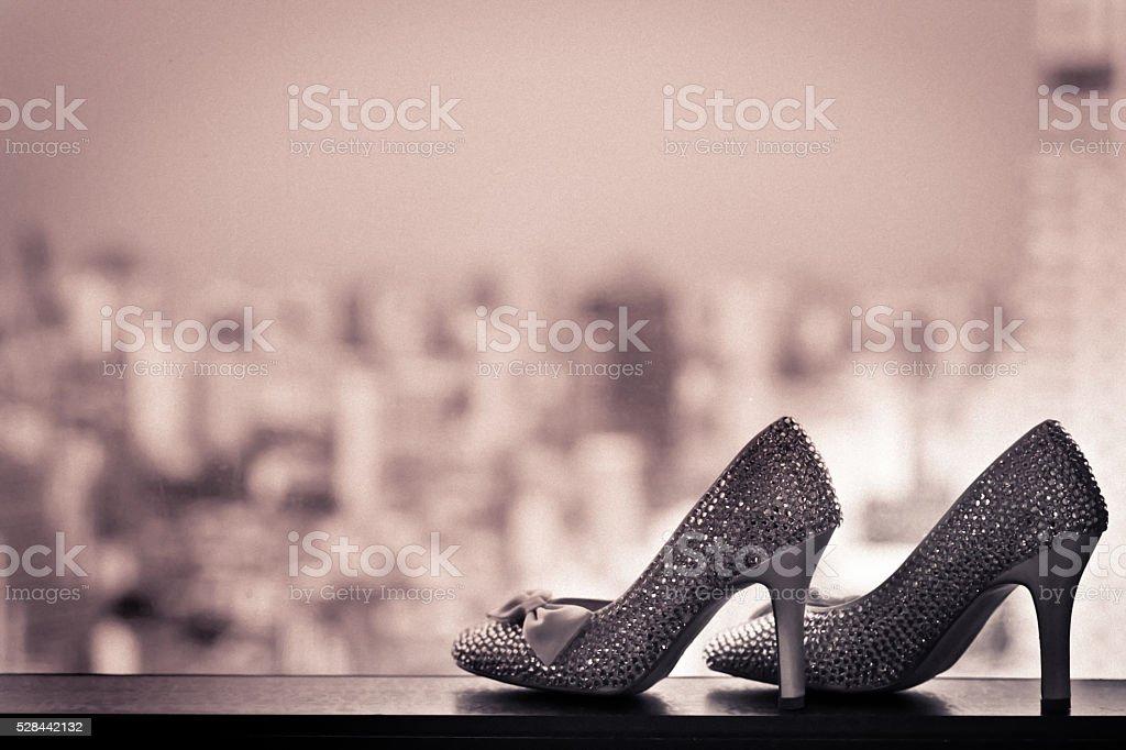Elegant bridal white shoes with rhinestones, closeup. stock photo