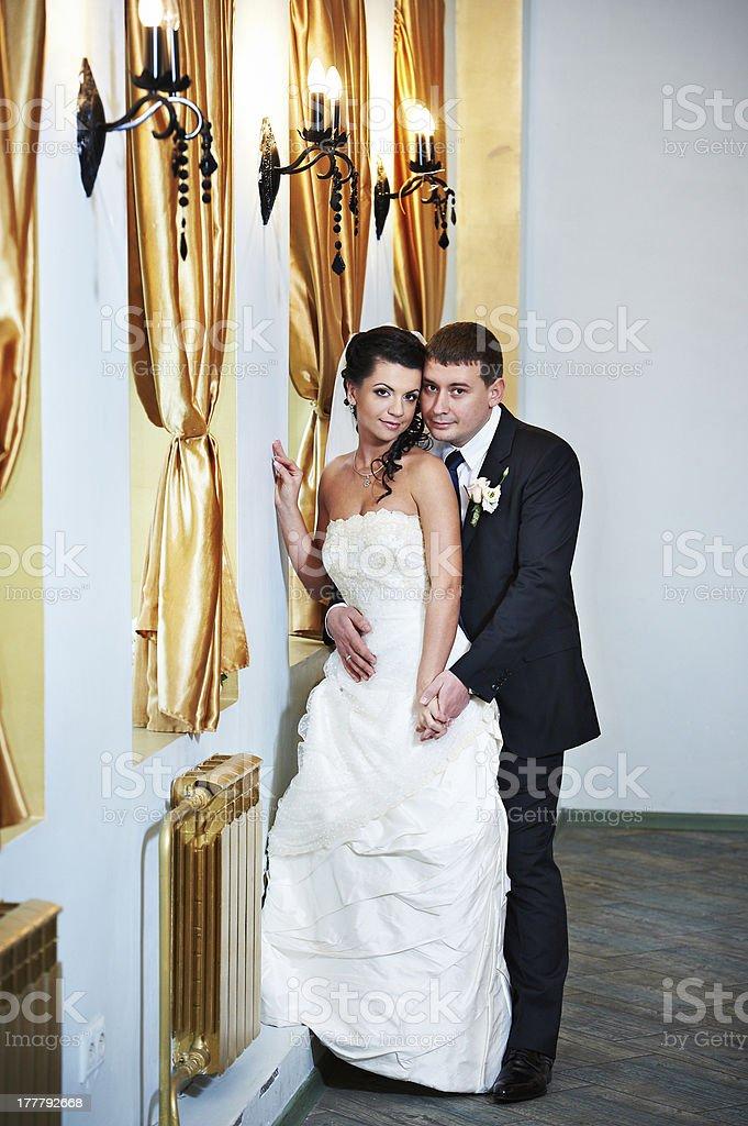 Elegant bride and groom in luxury interior stock photo
