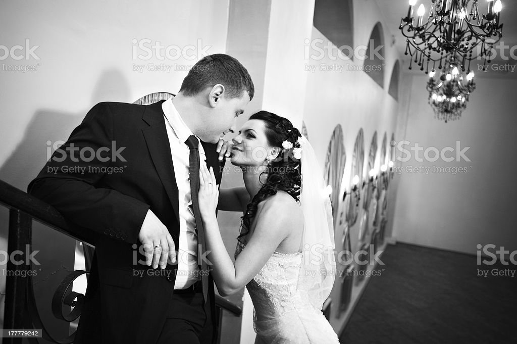 Elegant bride and groom in luxury palace royalty-free stock photo