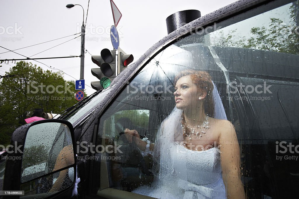Elegant bride into big car royalty-free stock photo