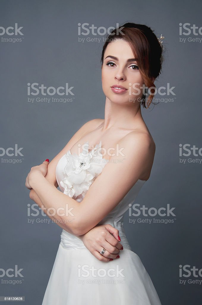Elegant bride with short hair updo and bare shouders dress stock photo