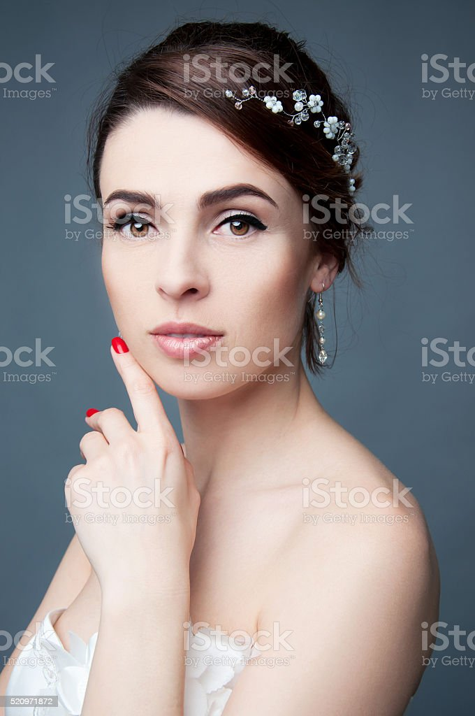 Elegant bride with short hair updo and bare shoulders stock photo