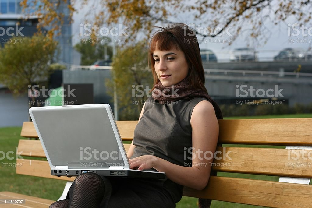 Elegant brunette woman with laptop royalty-free stock photo