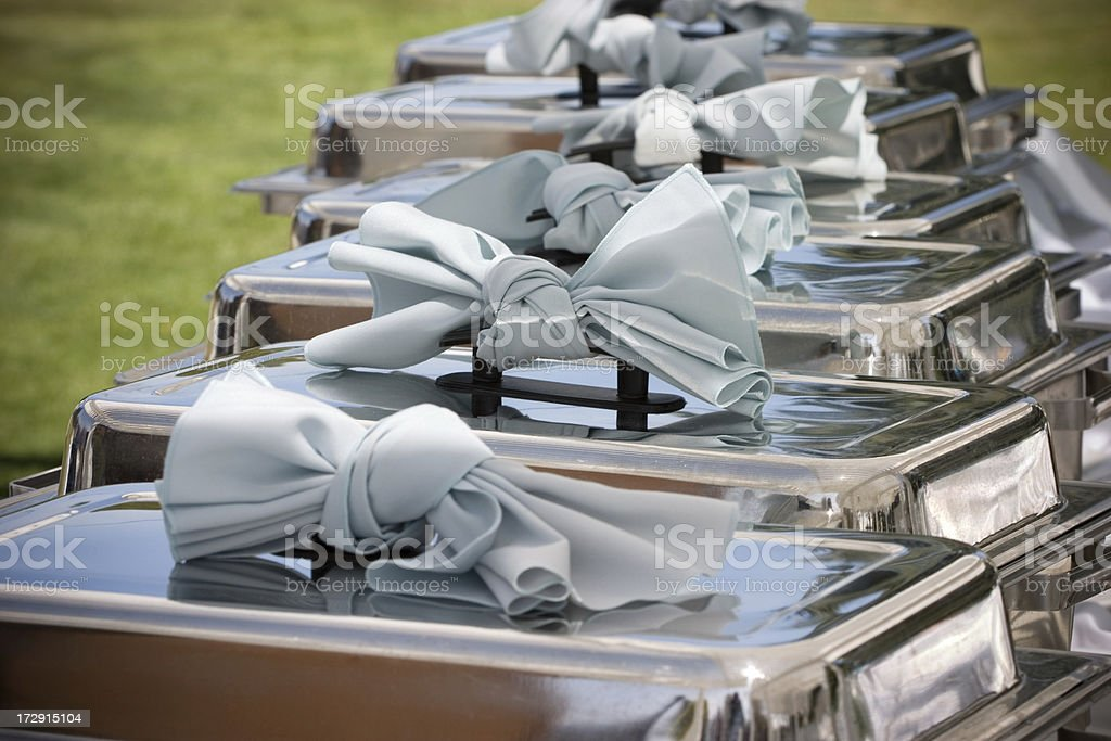 Elegant Buffet Table with Row of Food Service Steam Pans stock photo
