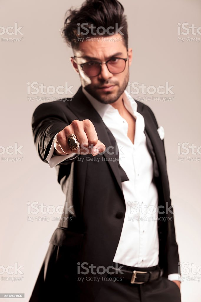 Elegant business man showing his fist stock photo