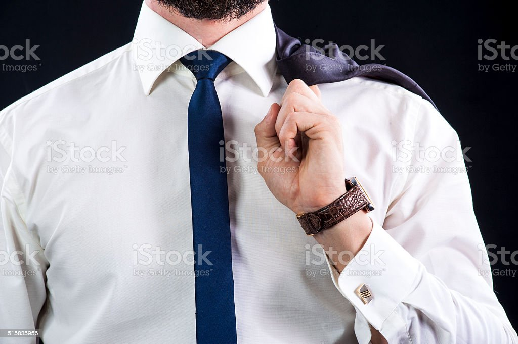 Elegant businessman holds his jacket stock photo