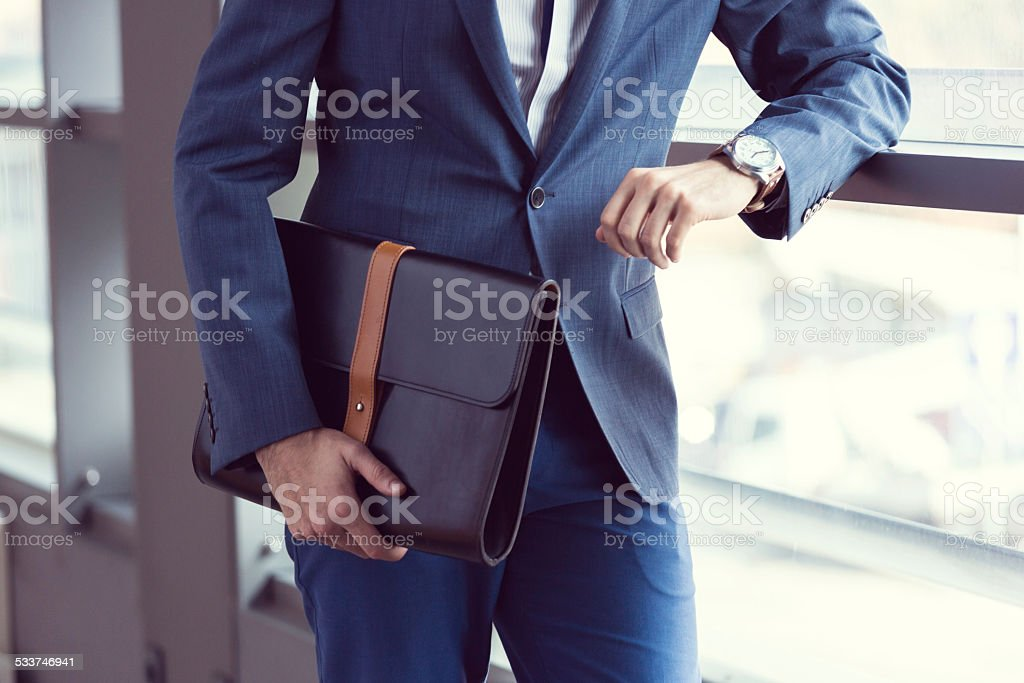 Elegant businessman in the office stock photo