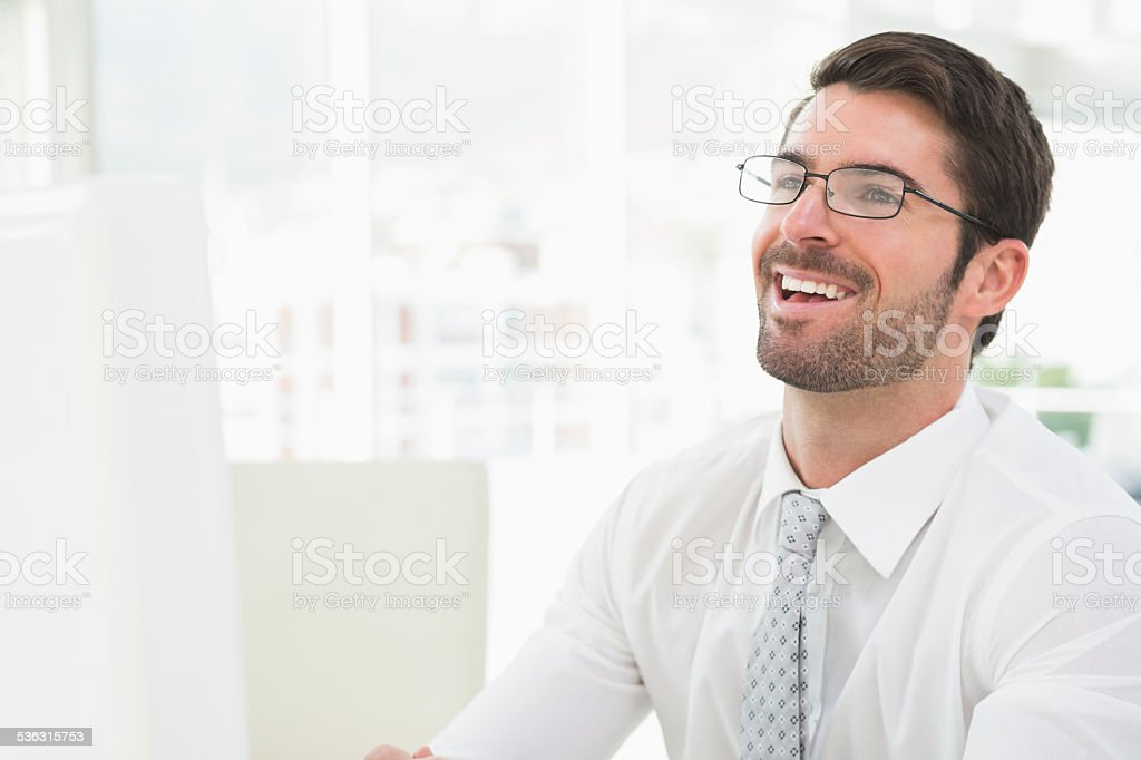 Elegant businessman with glasses laughing stock photo