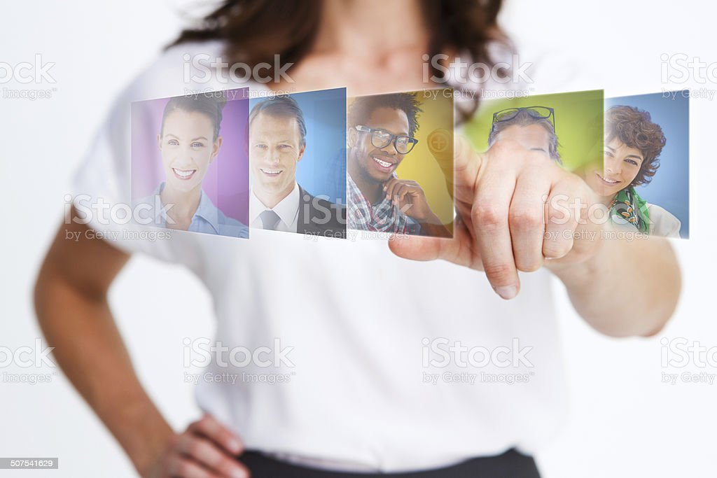 Elegant businesswoman selecting future employees stock photo